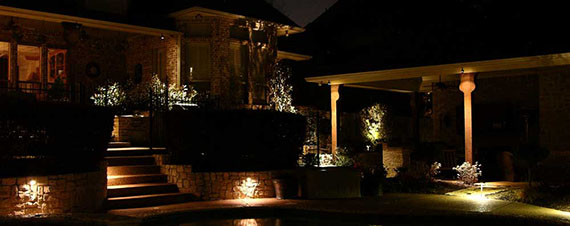 lighting installed around a pool light up the evening