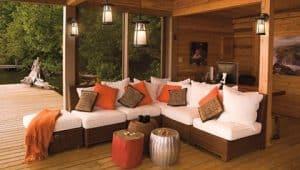 Stylish patio furniture around a well lit outdoor kitchen