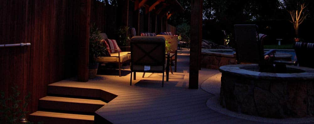 Outdoor lighting sets the mood on the deck around a pool