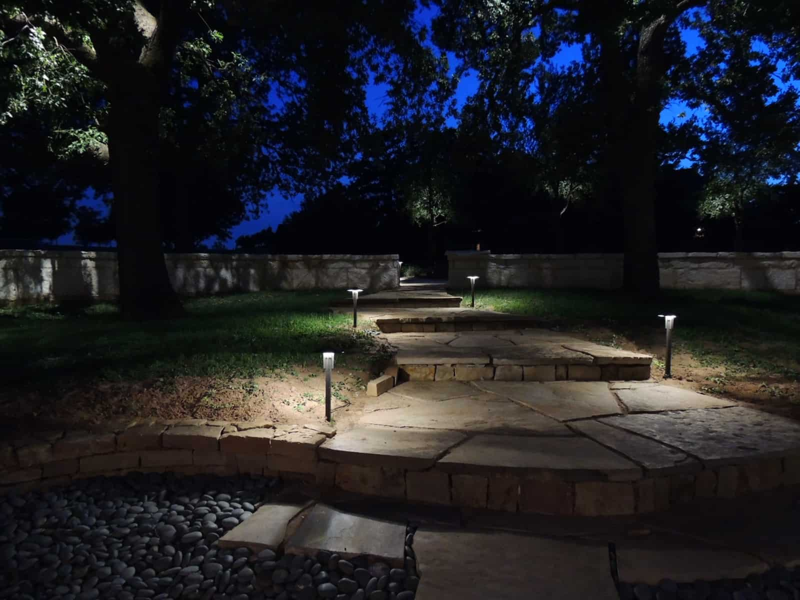 LED Light fixtures line a stone pathway