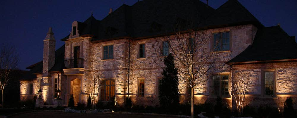 A palatial Westlake home is lit up at night