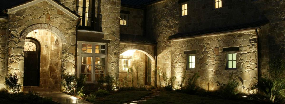well designed lighting accents the beauty of a stone wall at night