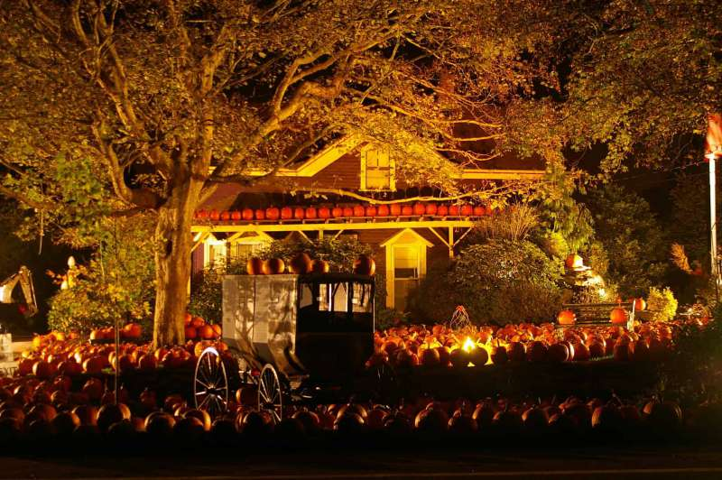 A home decorated for the Harvest season is lit up at night