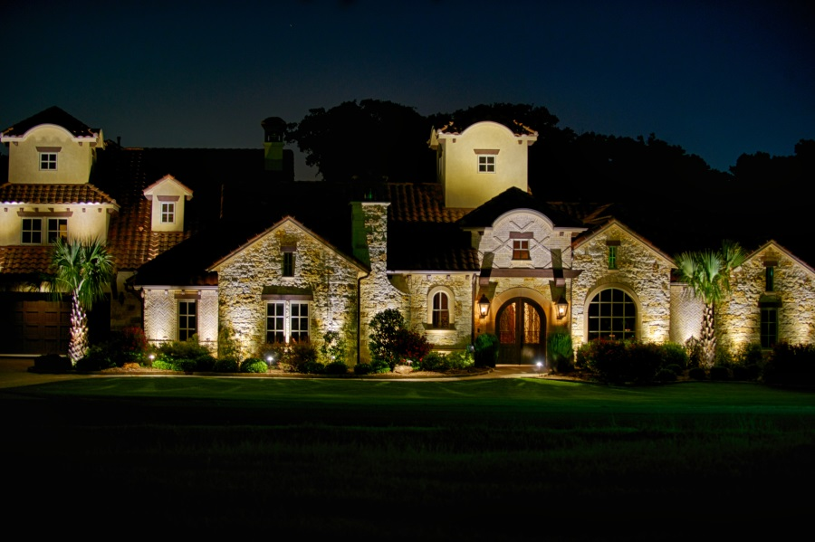 Outside lights illuminating a house during the night