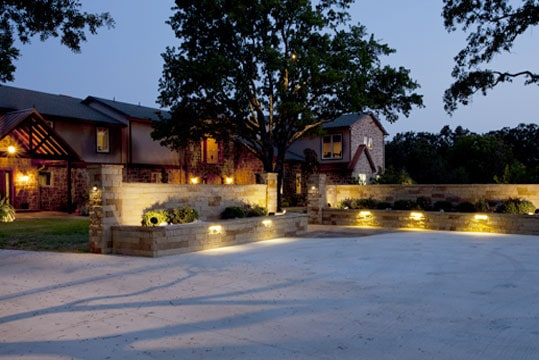 Nice home with well-lit driveway at night