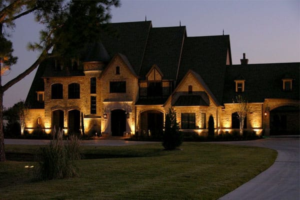 Exterior of large two-story house at night