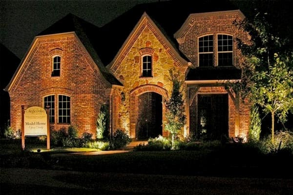 Lighting improves the curb appeal of a model home