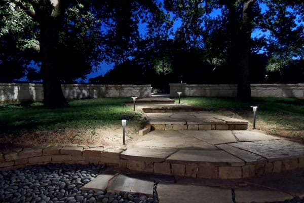 Stone walkway steps lit up with LED pathway lights