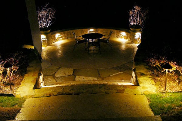 Well-lit garden patio at night