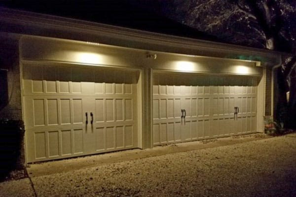 Three car garage light up at night