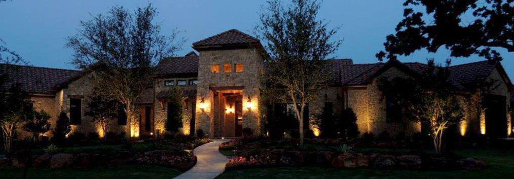 Large single-story home with security lighting