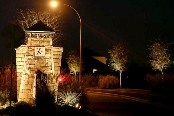 Stone neighborhood entrance at night